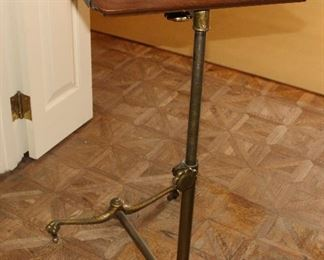 Brass bottom beside table, telescopes and rotates