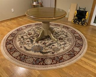 wood table and large rug