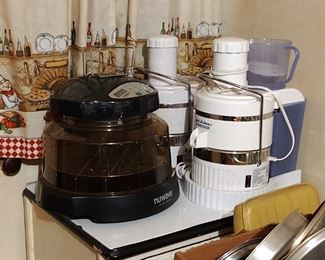 Misc. small appliances, Jack LaLanne juicers and more. Enamel top floor cabinet.