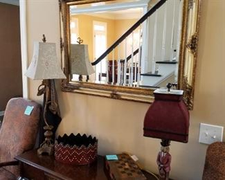 Broyhill foyer console and animal print arm chairs. Lots of beautiful lamps and accessories found throughout the home, too!!