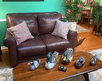 Collectible ducks and Leather sofa