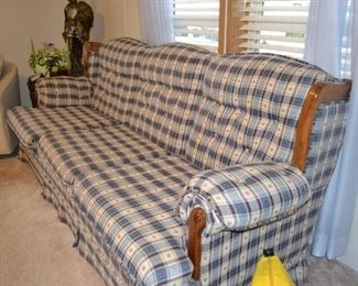 Country styled three cushion sofa in good condition.