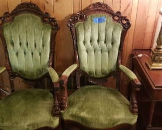 Pair of antique upholstered arm chairs