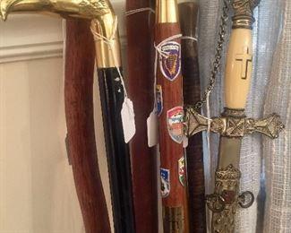 Several walking sticks and a Masonic sword