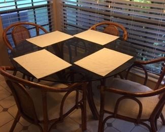 Glass top rattan kitchen set with set of four matching chairs