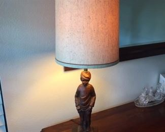 Wooden based carved antique lamp with base as image of boy