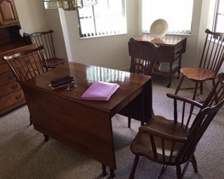 Stickley Cherry drop leaf dining table with matching two arm chairs and four chairs. Wine cart pictured in background