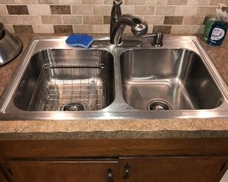 Stainless dual bay sink and fixtures