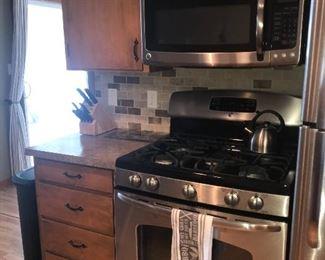Kitchen cabinets, gas range, microwave
