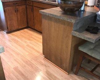 Flooring, kitchen cabinets