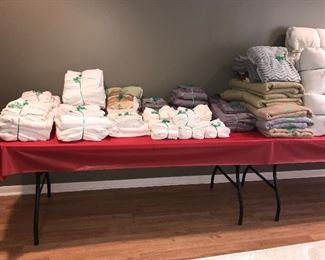 Thick, quality linens and mattress pads in Full and King sizes.    Many blankets including Ralph Lauren,