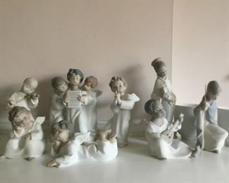 Vintage  Retired LLADRO Matte Figurines. Angel Playing Violin No. 4536, 3 Angels Singing No. 4542, Angle Playing Flute No. 4540,  Angel Thinking No. 4539, Angel Laying Down No. 4541, Angel Playing Lute (Black Legacy ), Joseph No. 4672 (Children's Nativity), King Balthasar No. 4675 (Children's Nativity)