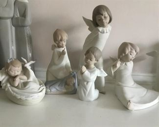 Vintage  Retired LLADRO Matte Figurines. Baby in Basket Comforting Dreams No. 6710, Angel with Baby No. 4635, Angel Kneeling and Praying No. 4538, Angel Sitting and Dreaming No. 4961, Angel  Standing -Curious Angel No. 4960.