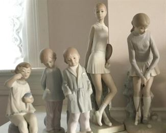 Vintage  Retired LLADRO Matte Figurines. Girl with Lipstick and Doll No. 1083, Punishment No. 4899, Boy in Robe No. 4900, Tennis Player Girl No. 4798, Lady Golfer No. 4851.