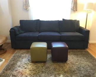Navy Blue Microfibre Sofa. 2 Leather Ottomans. Area Rug, Floor Lamp.