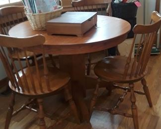Oak Pedestal Table, it has been refinished. 4 maple chairs.