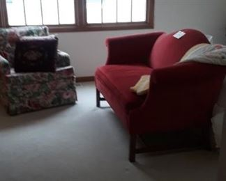 Red victorian style settee.