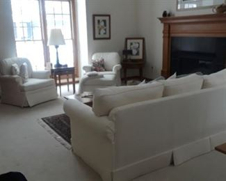 Formal white sofa and  1 stationary chair, 1 rocker.