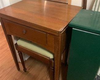 Vintage sewing machine in cabinet