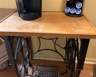 Keurig  coffee maker, and cast iron antique sewing machine base made into table