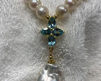 Genuine freshwater pearl necklace with topaz gemstones in sterling silver setting