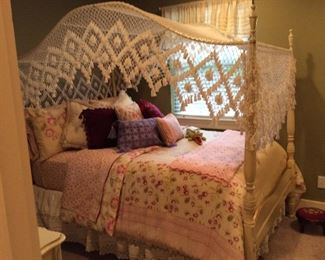 Cute white bed with canopy
