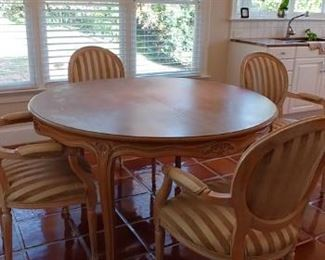 $650 White washed hardwood table with hidden leaf  $150 each 4 white washed hardwood chairs