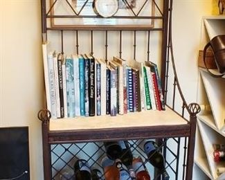 $250 Wrought iron baker's rack with travertine top. Other items in picture are not for sale.