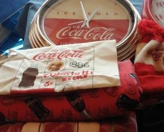Coke memorabilia clocks,pins, needlepoint,  coasters, cans, bottles,  advertisements, banks, Christmas ornaments, clothes and more