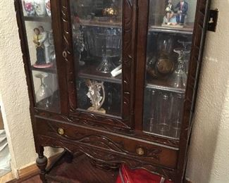 "Antique China Cabinet Has original Skeleton key. Measures 38 1/2"" wide x 14"" deep x 59"" tall."