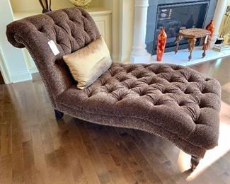 Animal print upholstered chaise.  Features animal print pattern and nailhead trim...like new!