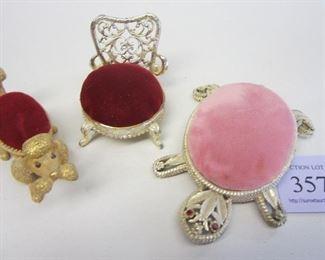 Figural pin cushions