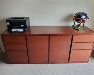 """Cherry Steelcase credenza (also matching desk) Good condition Steel and wood, so it is heavy – need to disassemble/reassemble Credenza: 19 ½"""" deep x 70 ½ wide x 29"""" tall 2 file drawers 4 regular drawers Middle cabinet with 2 shelves (25"""" wide) (Note: I do not have the keys to the locks – but they can be gotten form Steelcase with the numbers on the locks) $250 each"""
