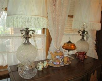 pair of large crystal lamps & tea set on record cabinet