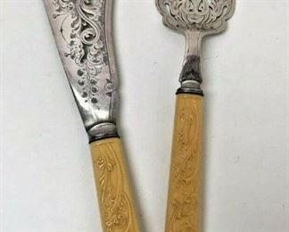 M003: ORNATE FORK AND KNIFE SERVING SET STAINLESS STEEL AND CELLULOID   https://www.ebay.com/itm/123952007901