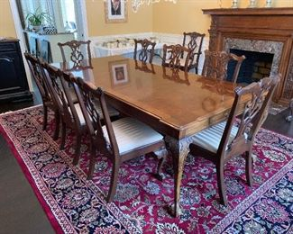 "Henredon Rittenhouse Chippendale style dining room table, 2 leaves, 10 chairs. Table measures 124"" X 46"" with 2 - 24"" leaf inserts in place. Pistol drawers measure 18"" x 12"" x 15"". Chairs are Model No. 5053 - 27 and 28. Table is model 5001-20. Excellent condition."