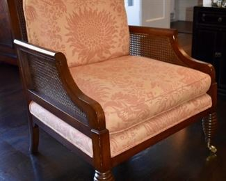 One of a pair of caned arm chairs