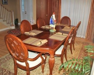 "Tommy Bahama dining table with two leaves 96"" x  43.5"" x  29.5"".  Six chairs 17.5"" to seat, 41.5"" to top of back. Excellent condition and perfect beige upholstery.  Asking $1200"