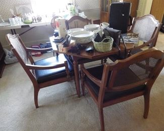 Cane back chairs and table