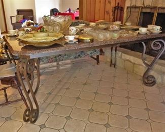 Wrought iron base dining table with marble top