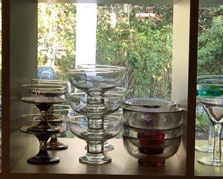 Various sets of dessert serving dish sets.