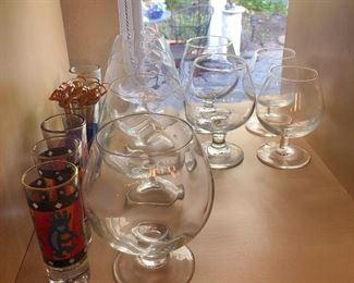 Kokapeli shot glasses set of two, graphic shot glasses set of 4, large brandy glasses set of 4, medium brandy glasses set of 4, small brandy glasses set of 4.