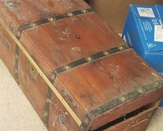 antique wood box. missing one side panel. Our client believes the panel is here.