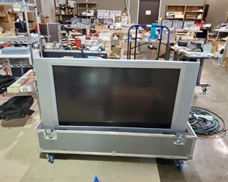 Big screen TV in a travel case - Works! Top cover included not pictured.