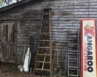 Assorted vintage ladders and a couple of Kangaroo signs.