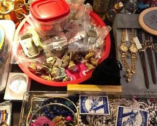 Several tables of costume jewelry, small collections, a couple of clocks, over 100 Dvds, some new. Collection of costume silver chains, coffee table books, vintage lamps. Kitchen stuff in great shape including small appliances new in box.