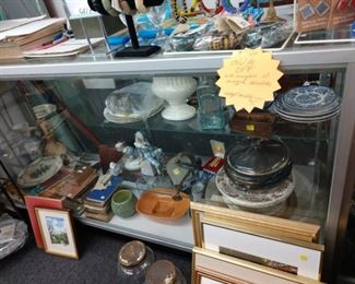 Items within display cases and artwork, jewelry 30-75% off depending on vendor;   display cases for sale
