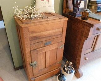 Awesome antique oak icebox in original condition including wooden casters