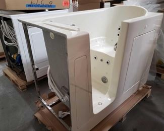 """413: Therapy Tubs Model 3055 with Jets and Pump Measures approximately 30"""" x 55"""" x 39"""" tall"""