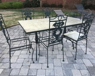 Glass top patio table and six chairs